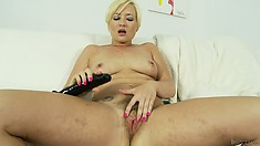 Horny blonde needs some relief so she uses one of her big toys