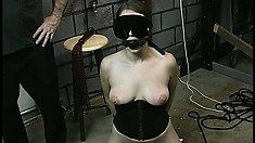Joleen is strung up in the dungeon and gets her nipples clamped