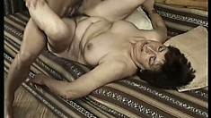 Brunette granny grinds her stale snatch on his pulsating man meat