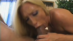 The busty blonde milf moves on top of him and rides his stiff cock with pure desire