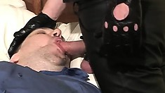 Leather daddy gets blown by a fat dude who keeps his clothes on