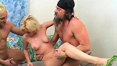 Naughty blonde with lovely tits Michelle has two studs sharing her fiery pussy