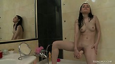 Petite Nara touches herself and rubs her smooth clit with a huge dildo