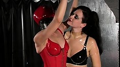 Kinky lesbians with a love for latex get freaky in their dungeon