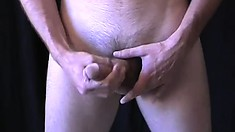Skinny white guy strokes his long cock while rubbing his sexy ass