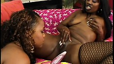Pussy-munching black starlets love to work each other's muffs with toys
