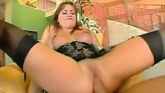 Busty redhead in black stockings Katin needs to have a stiff dick invading her ass