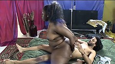 With her big booty all oiled up, a chubby ebony lady gets fucked by a black stud
