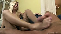 Insatiable blonde works a lusty womanizer's cock with her feet