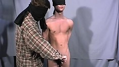 A couple of gay guys such each other's cock while blindfolded