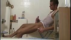 Lusty playboy enjoys juicing his own bulging prick under the shower