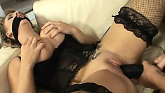 Voluptuous blonde in sexy black lingerie has sexual desires to fulfill