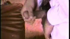 Nasty guy in glasses and classy short gets his dick rubbed by partner's feet