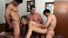 Buxom blonde cougar Ciera Sage gets fucked by two guys in the office